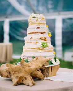 Susan and Cartter chose a naked cake with icing dripping down the sides, made by Classic City Confections for their Georgia wedding.