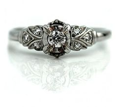antique engagement ring flanked center appx 0.15 cts flanked by  6 single cut diamonds circa early 1900's. #weddings