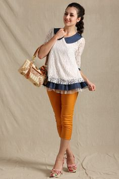 This blouse crafted in polyester, featuring contrast colored peter pan collar, medium sleeve, three-layer hemline, in medium length cut.