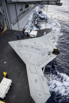 An X-47B Unmanned Combat Air System (UCAS) demonstrator aircraft is transported on an aircraft elevator aboard the aircraft carrier Harry S. Truman (CVN 75).