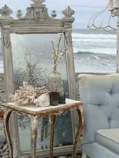 By the sea, I have wildly romantic notions about old mirrors, seashells, old junky things that make cozy nests, the salt air, the sound of waves crashing on the shore.... PERFECT picture!
