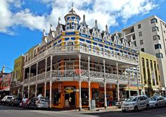 Long Street in Cape Town is party central! So, we invite all party animals to enjoy a drink in the hottest nightclubs around. Cape Town, Victorian Architecture, Blue Mountain, Africa Travel, Vacation Spots, Old Houses, South Africa, Street View, Backyard
