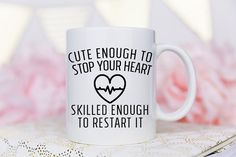 This Cute Enough to Stop your Heart, Skilled enough to restart it mug is the Perfect gift for doctors, nurses, medical student graduates, and all others