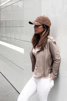 Brown suede baseball cap,brown leather jacket,brown shirt,white jeans