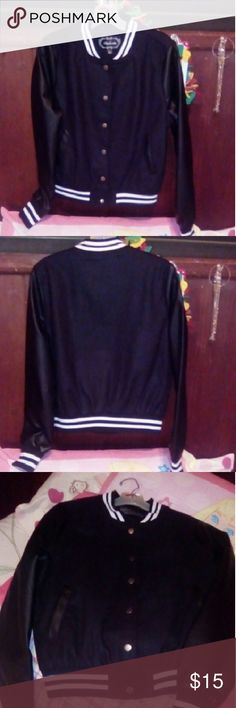 Black jacket, Never used black jacket,outer shell is10% wool and 90% polyester, the lining is 100% polyester with 600mm polyurethane coating contrast sleeve 100% polyurethane backing is 50/50 rayon polyester neck is spandex and polyester, dry clean only Ambiance Apparel Jackets & Coats