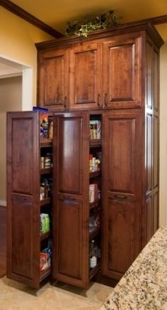 pull out pantry  I'd love to have one of these but maybe not in a dark wood finish.