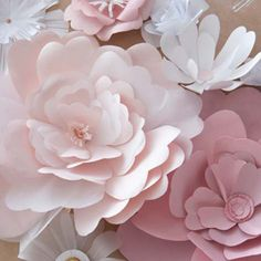 Two Methods To Craft Paper Flowers Tutorial ~    You need:  • sheet of colored cardboard for petals  • sheet of white paper for the stamen  • pencil  • eraser  • scissors  • embossing tool  • filigree split tool (usually used for quilling)  • metal ruler  • craft glue.    How To & Templates @  http://ideasmag.co.za/craft-decor/craft-paper-flowers/