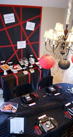 red and black decor is perfect for a spy party