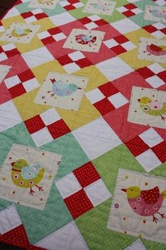 Birdie quilt. I love the red/white four patches. and colors, not so much on the birds. another themed panel, good setting.