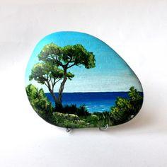 Peinture sur galet, bord de mer