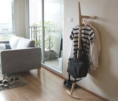 Minimalistic clothes rack. No holes needed on walls.