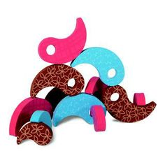 Unique paisley shaped thick and firm foam puzzle pieces with printed surfaces that stirs the imagination in new, abstract ways.