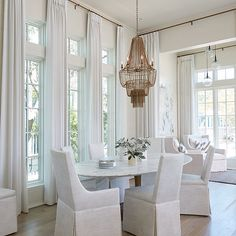 Brown Metal Fringe Chandelier with Oval Marble Top Dining Table