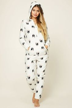 A hooded fleece PJ jumpsuit featuring a print of a French bulldog with antlers, a kangaroo pocket, zipper front, and long sleeves.