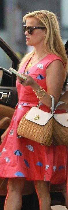 Who made  Reese Witherspoon's pink print dress, straw handbag, and wedge sandals?