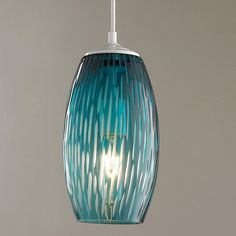 """Etched Lines Glass Pendant Light Lovely blue glass with deep etchings down the sides for texture. Flip the switch and a soft glow appears, brightening your space. Approximately 12"""" H x 5""""W. 60W max medium base socket."""