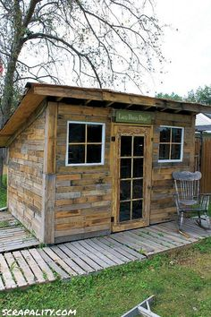 Shed Made From Pallets And Tin Cans