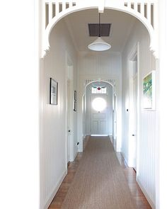 #Hallway. Love the #white-timber -panelling throughout and #seagrass -runner – so perfect here.