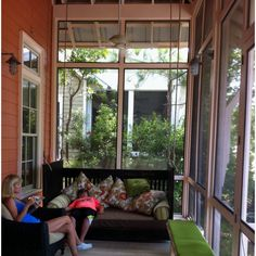 A comfy bed swing on screened front porch in Watercolor, Fl.