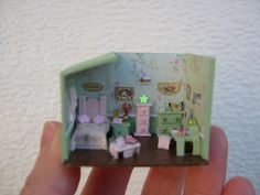 This is so cute and amazing, it looks like its a micro mini room box! Wondering what materials it's made from.