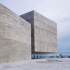 Board-marked concrete volumes with geometric shapes make up this seaside concert hall, built by Rojkind Arquitectos for the philharmonic orchestra of Mexican city Boca del Rio.