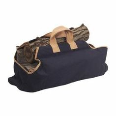 "Canvas log carrier in navy with contrasting handles and trim.      Product: Log carrier   Construction Material: Canvas   Color: Navy and ivory  Features: Can be used to store or transport wood    Hand-woven  Dimensions: 21"" H x 35"" W x 1"" D"