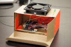 The DIY Turntable is a low-fi DJ set made with a PC fan for the scratching turntable, a hacked walkman to play cassette tapes at the desired speed, and an Arduino to map these two. There are also some LEDs to show the speed of the song in another way.