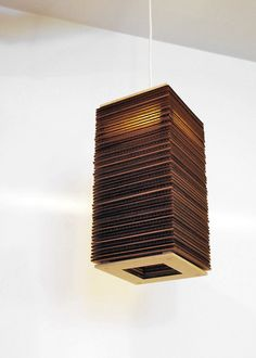 Tall Boy - Modern Hanging Corrugated Cardboard Lamp Light Tower Pendant by CORRUG. $79.00, via Etsy.