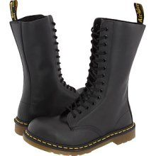 Tall, lace-up doc Martens, over jeans