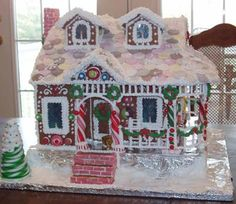 Victorian Gingerbread House 1. Hard to see but there are 2 icing rocking chairs on the front porch: I made this house as a donation to the local hospital foundation to auction or sell at this year's Festival of Trees.