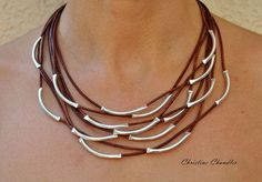 Leather and Sterling Silver is a wonderful combination for jewelry. This fun necklace design is another must have. This leather and sterling silver necklace is 8 strands of leather with 16 pieces of Sterling Silver secured in place. It falls 18 to 20 inches. The clasp is a beautiful magnetic stainless steel. You can order this in any color leather that I have. In the photos are Medium Brown, Black, Light Brown & Metallic Grey. I also have a variety of Leather and Sterling Silver Bracelets...