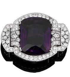 An amethyst and diamond brooch The large fancy-cut amethyst within an old brilliant and brilliant-cut diamond frame, between pierced shoulders of geometric design set with similarly-cut diamonds, diamonds approx. 2.75cts total, width 5.2cm
