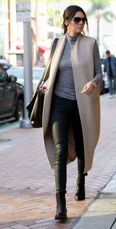 Kendall Jenner in Skinny Black Coated Jeans. Kendall chose a tight-fitting, long-sleeved, grey turtle neck t-shirt for her top, paired with skinny black