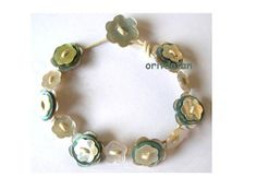 Bracelet made of buttons button jewelry made of by oritdotan, $15.00