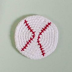 This crochet baseball is perfect to decorate a children's room or use as coasters for entertaining friends you've invited over to watch spring training. Check out the pattern by @petalstopicots