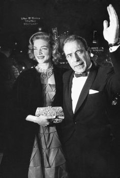 Humphrey Bogart and his wife Lauren Bacall arrive at the 27th annual Academy Awards at the RKO Pantages Theater in 1955
