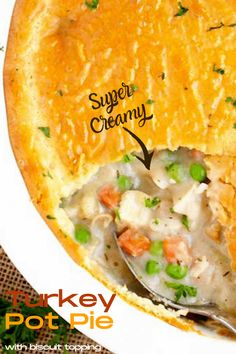 Turkey Pot Pie is the perfect way to use up your holiday leftover roasted turkey. This Turkey Pot Pie recipe is loaded with turkey and vegetables baked in a creamy, rich and savory sauce and topped with a tasty, golden biscuit crust. #easy #recipe #withbiscuits #leftovers #withbisquick #casserole #turkey Supper Recipes, Lunch Recipes, Easy Dinner Recipes, Great Recipes, Easy Meals, Favorite Recipes, Turkey Recipes, Fall Recipes, Holiday Recipes