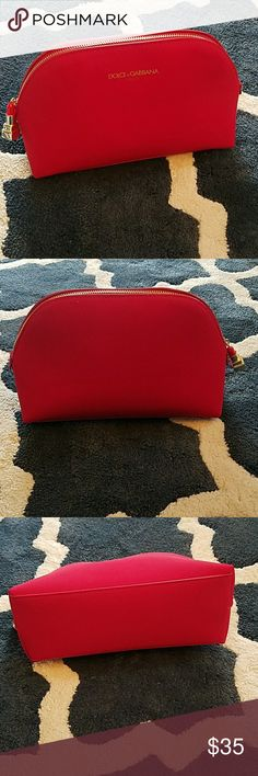 "DOLCE & GABBANA RED BEAUTY COSMETIC BAG DOLCE & GABBANA RED BEAUTY COSMETIC BAG. IN NWOT CONDITION. SMOKE FREE HOME. APPROX. MEASUREMENTS: 9""L x 6""H x 3.75"" D Dolce & Gabbana Bags Cosmetic Bags & Cases"