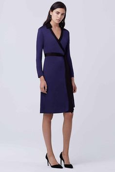 Contrasting black and cobalt blue makes a statement on this classic wrap style.
