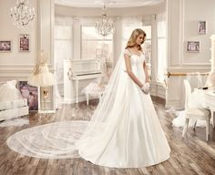 Damaris by Nicole Spose is a classic a-line gown.