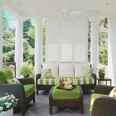 Love this! Very similar to our wicker furniture we have for our sunroom. Love how they have it accessorized!