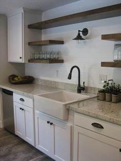 """Farmhouse Sink - Ikea Flooring - Home Depot Montagna Rustic Bay Cabinets, Island, Floating Shelves, & Hardware - Rob Terry Cabinets Granite Counter tops - """"River White"""" from Arizona Tile, Fabrictor - Creative Granite & Design Faucet - Lowes Above the sink light fixture - Restoration Hardware:"""