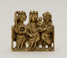French fifteenth-century openwork ivory panel (fragment) showing St Catherine of Alexandria with attributes, the Virgin and Child and St John the Baptist with the lamb of God. (Museum Mayer van den Bergh, Antwerp, Belgium/The Courtauld Institute of Art)