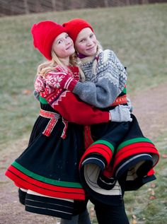 happy picture of girls wearing traditional Scandinavian dress called 'burgen' this style comes from the Lundlia area in Norway where our family lived
