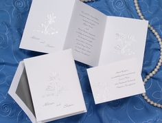 Daisy wedding invitations with the sweet sentiment - he loves me, she loves me - is featured on this classic silver foil daisy design on a bright white invitation. Your names are on the front by Wedding Invitations -The Office Gal