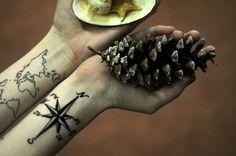 world and compass tattoo