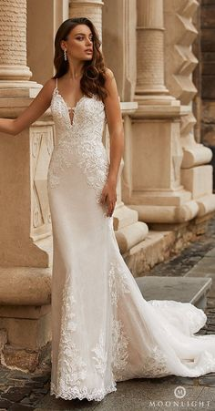 Lace mermaid wedding dress with deep v-neckline and spaghetti straps | Moonlight Bridal Collection Spring 2021 Wedding Dress - J6812 - Belle The Magazine #weddingdress #weddingdresses #bridalgown #bridal #bridalgowns #weddinggown #bridetobe #weddings #bride #dreamdress #bridalcollection #bridaldress #dress See more gorgeous bridal gowns by clicking on the photo