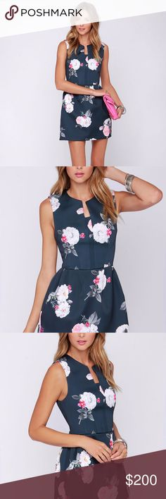 Cameo Dress - Outcome Sleeveless Floral Print Scub You can bet on a stunning display from the Cameo The Outcome Grey Floral Print Dress, and you'll always get results! Thick grey satin has a pretty floral print with shades of white, neon coral, and purple contributing to the chic, modern vibe. A notched, rounded neckline is centered on a darted bodice, while a sculpted bell skirt offers a curvy conclusion. Hidden back zipper. Fully lined. 100% Polyester. Dry Clean Only. Fit: This garment…