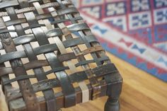 Use leather belts to refinish old foot stools. Could probably use old stirrup leathers too.
