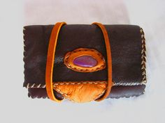 """Purple Jadeite and dark brown& tanned leather wallet. Such a beautiful colour stone, also known as a 'Lavender Jade'.  """"The history of jade goes back several thousand years when jade was first used to make weapons and tools because of its toughness."""""""